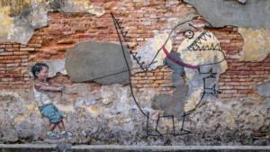 Malaysia: Eine Zeichnung von einem Jungen, der einen Dinosaurier an der Leine hält.